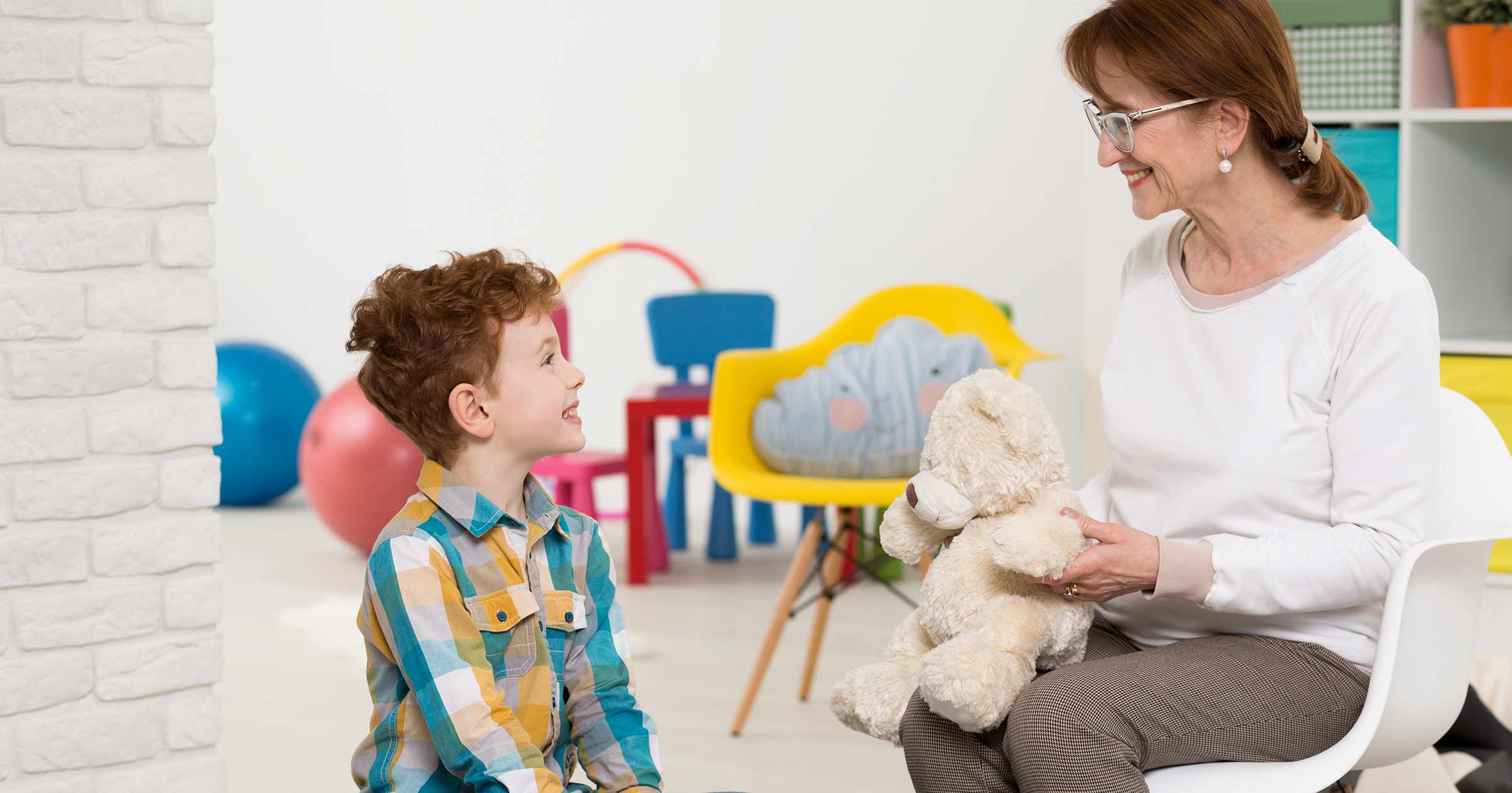 therapist with autistic boy